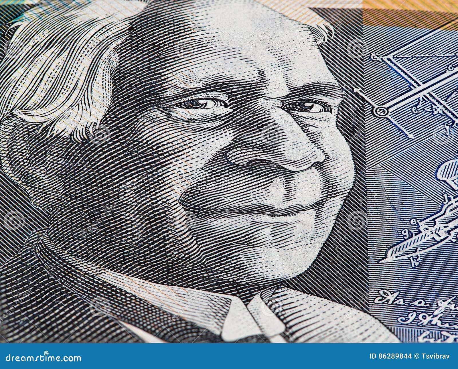 Australian 50 dollar bill macro - portrait of David Unaipon closeup.