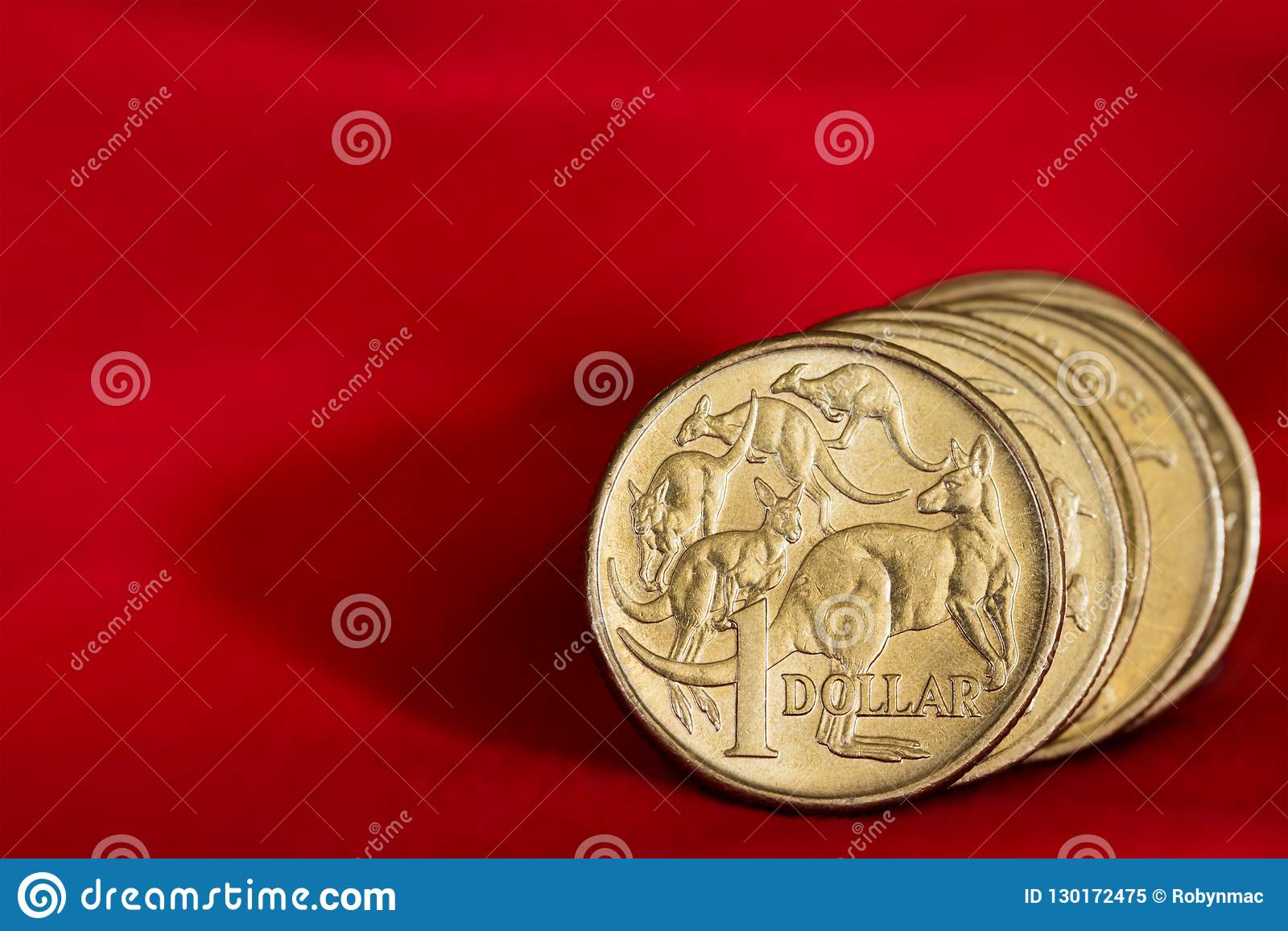 Australian Dollar Coins over Red Background