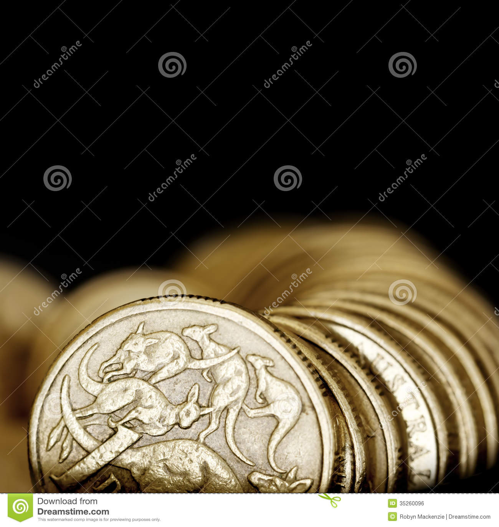 Australian One Dollar Coins over Black