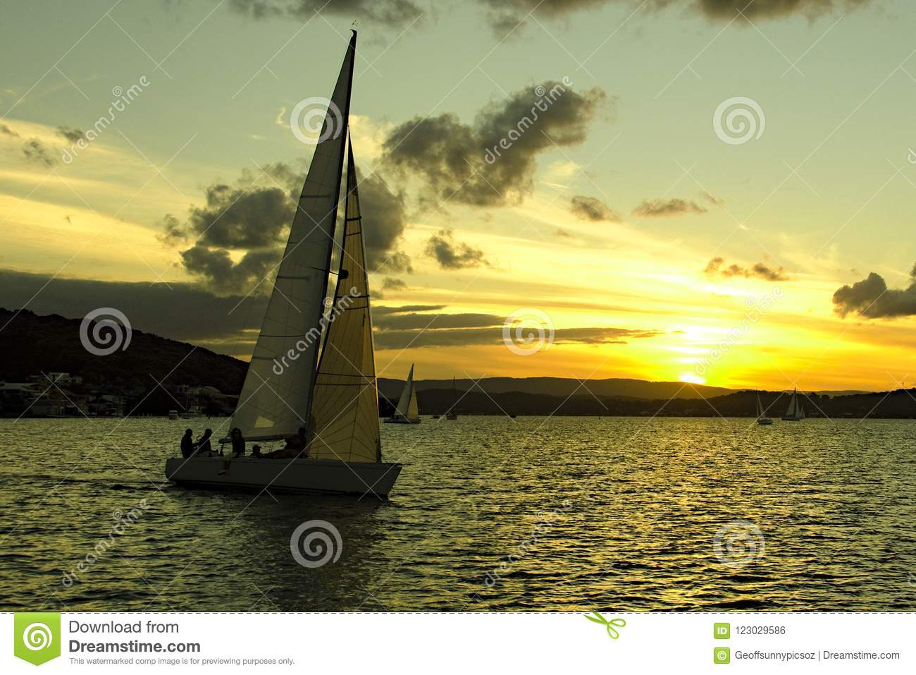 Yellow coloured stratocumulus cloud, sunset seascape over a sail