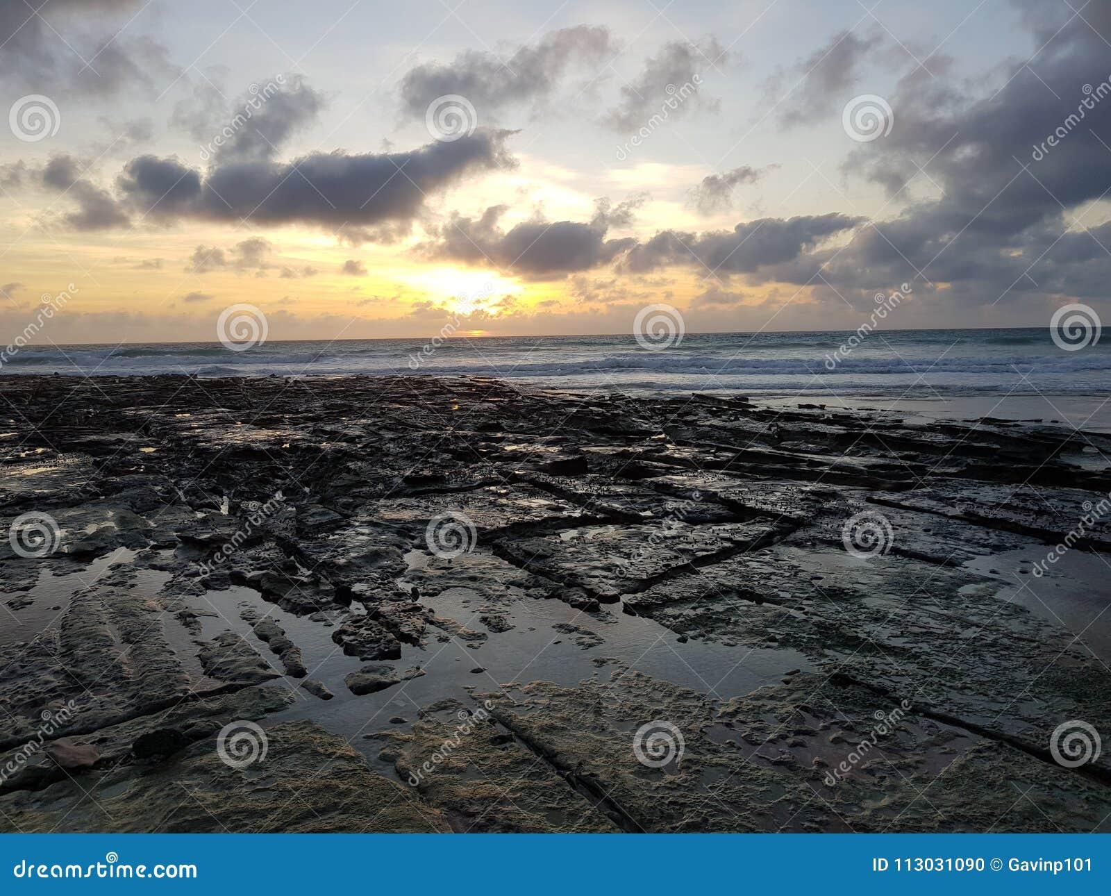 Australiano de Broome de la playa del cable de la puesta del sol interior