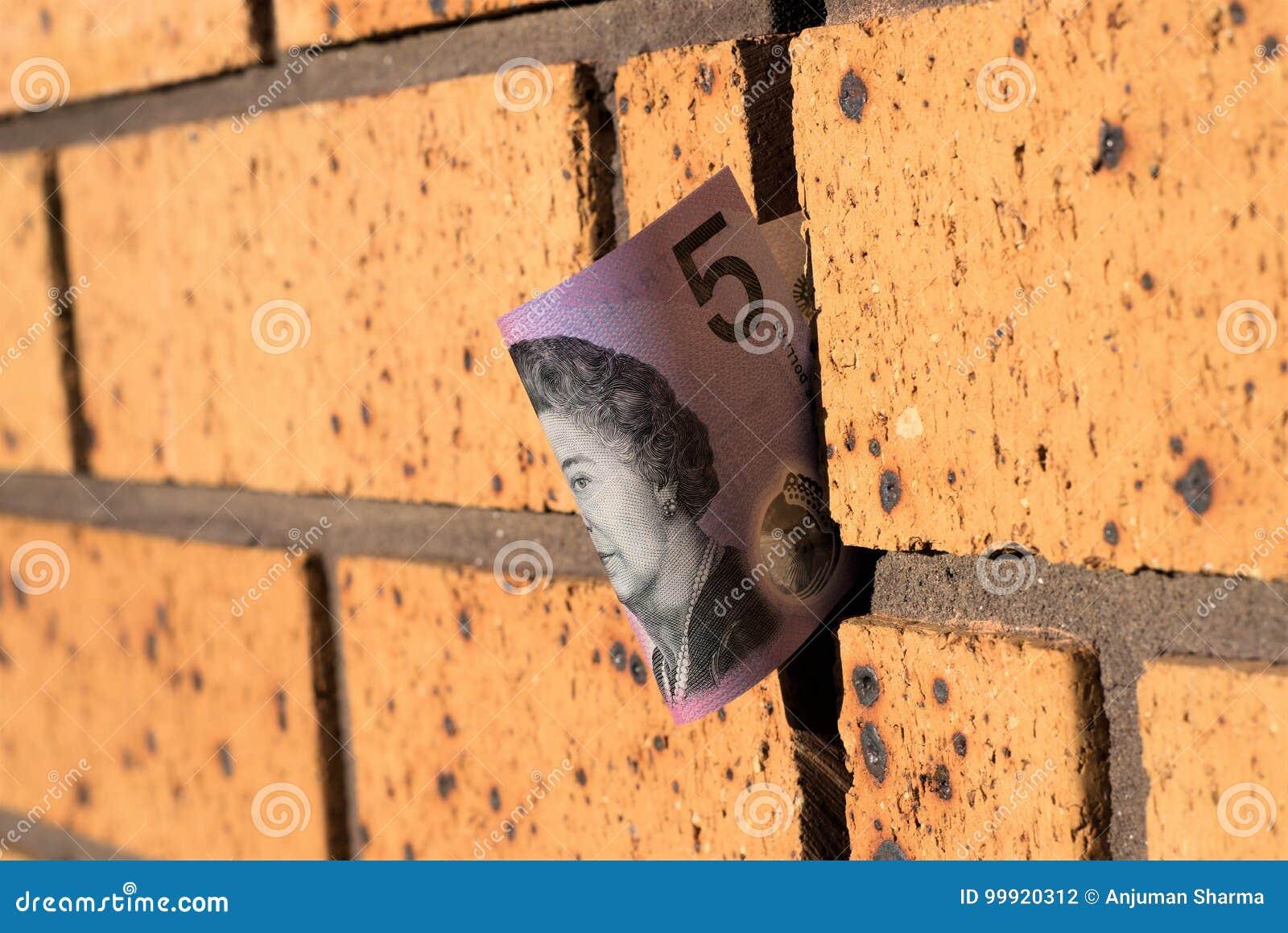Australier fem dollar anmärkning på väggen