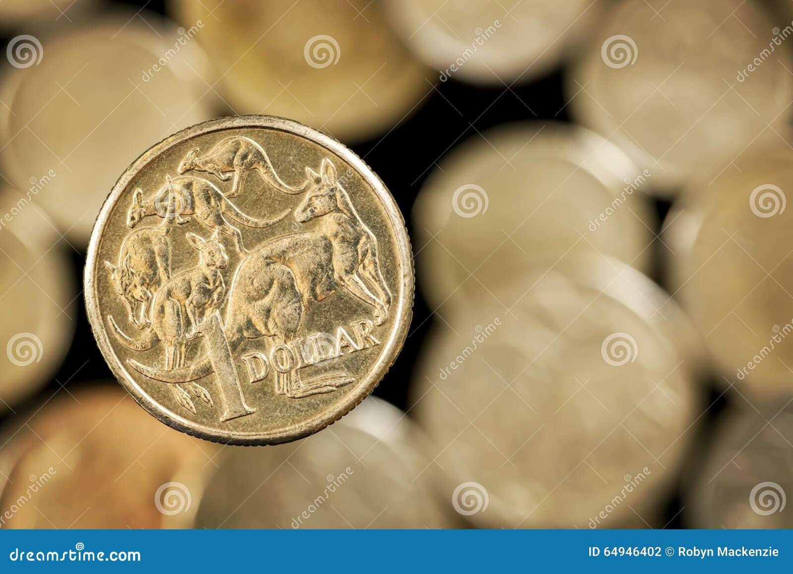 Australische Dollarmuntstuk over Vage Gouden achtergrond