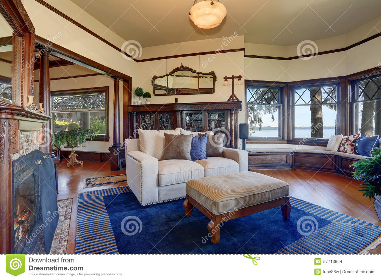 authentic styled living room with royal blue rug. stock photo