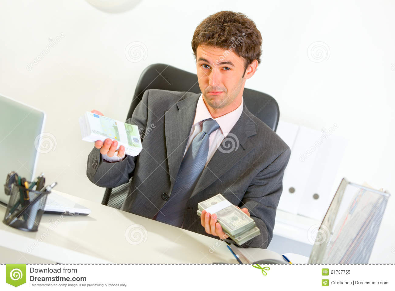 Authoritative Businessman Sitting At Desk Royalty Free ...