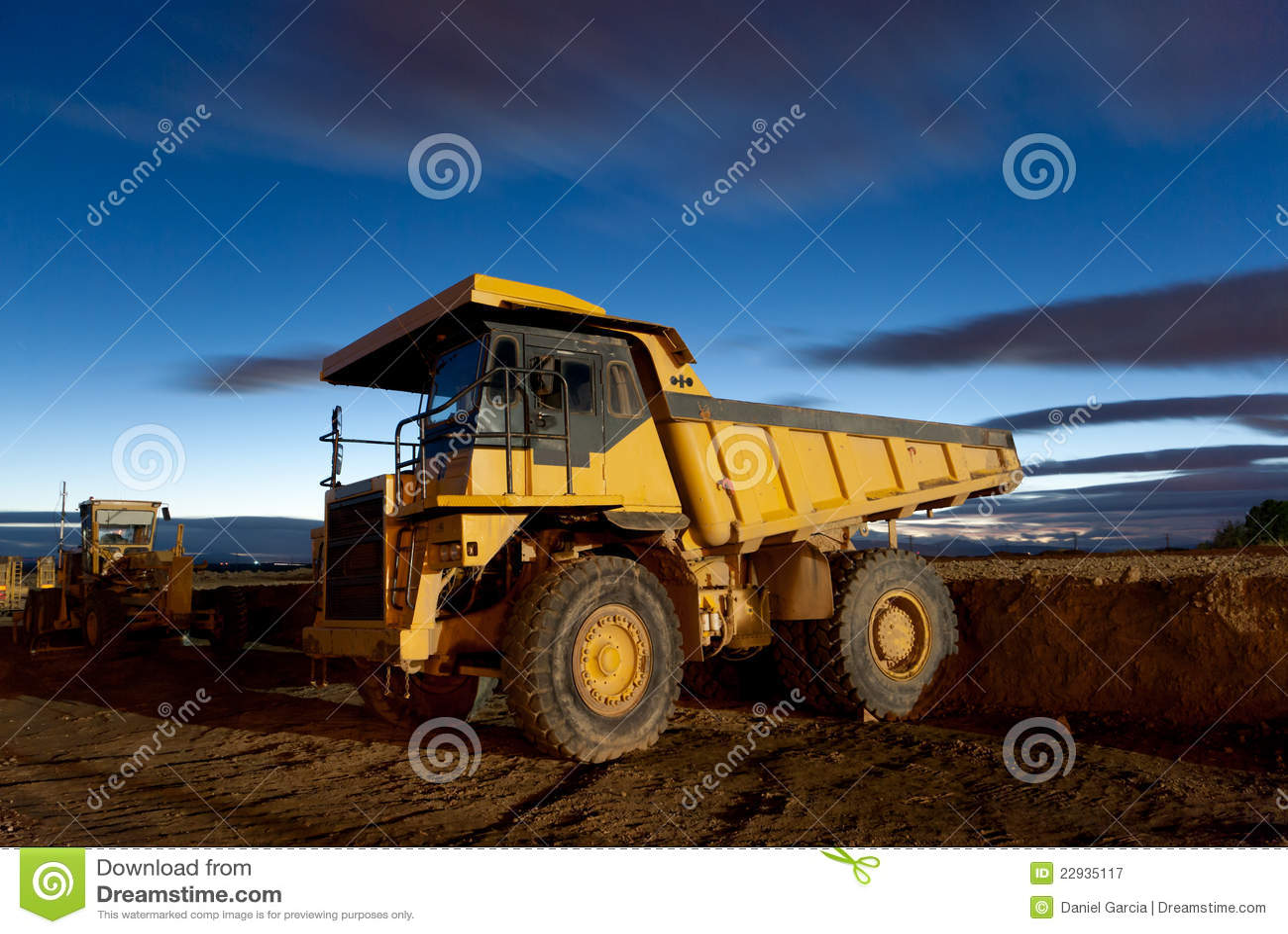 Auto-dump yellow mining truck night excavator