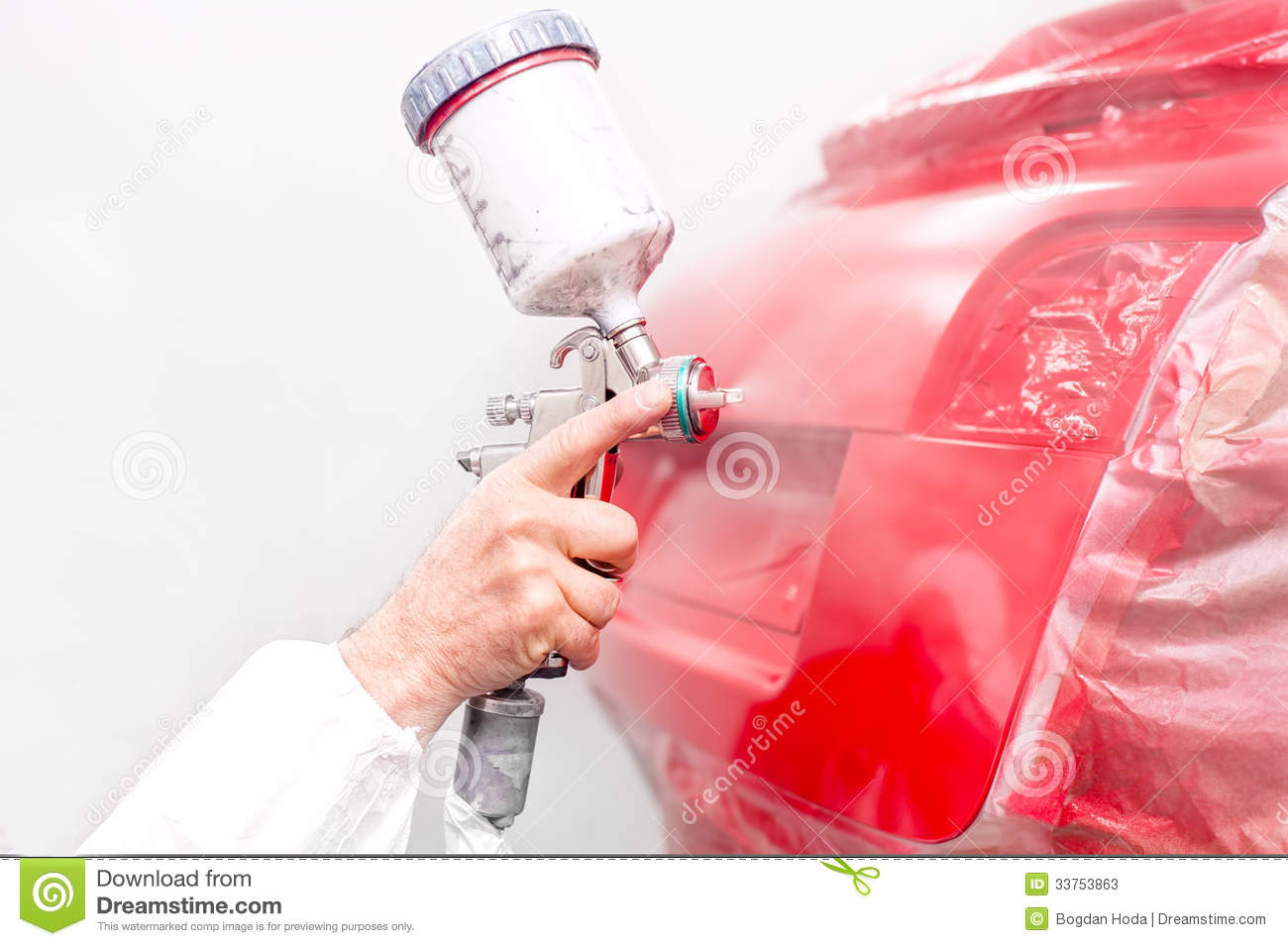 Auto Engineer Painting A Red Paint On Modern Car In