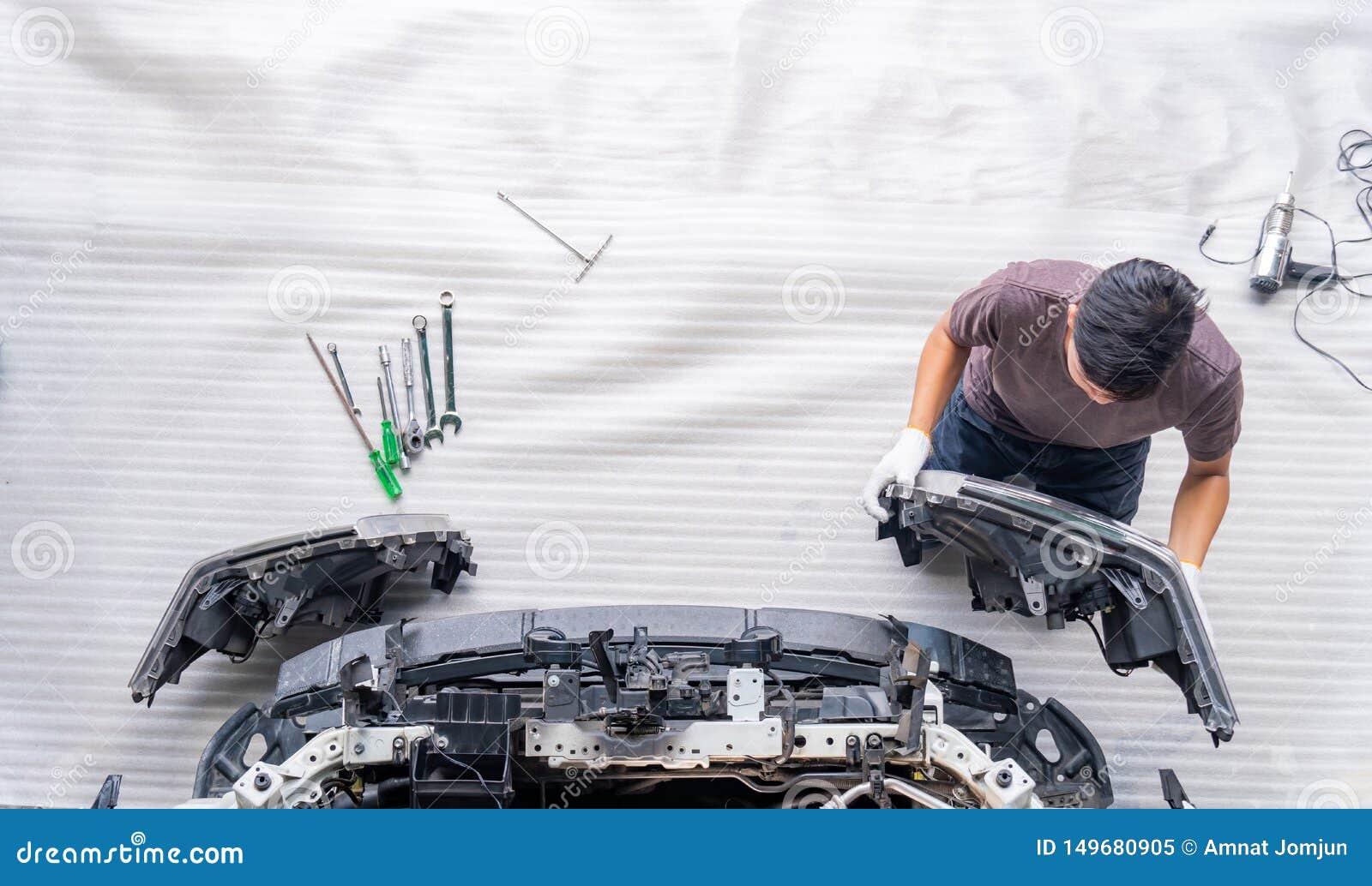 Auto mechanic is assembling car parts