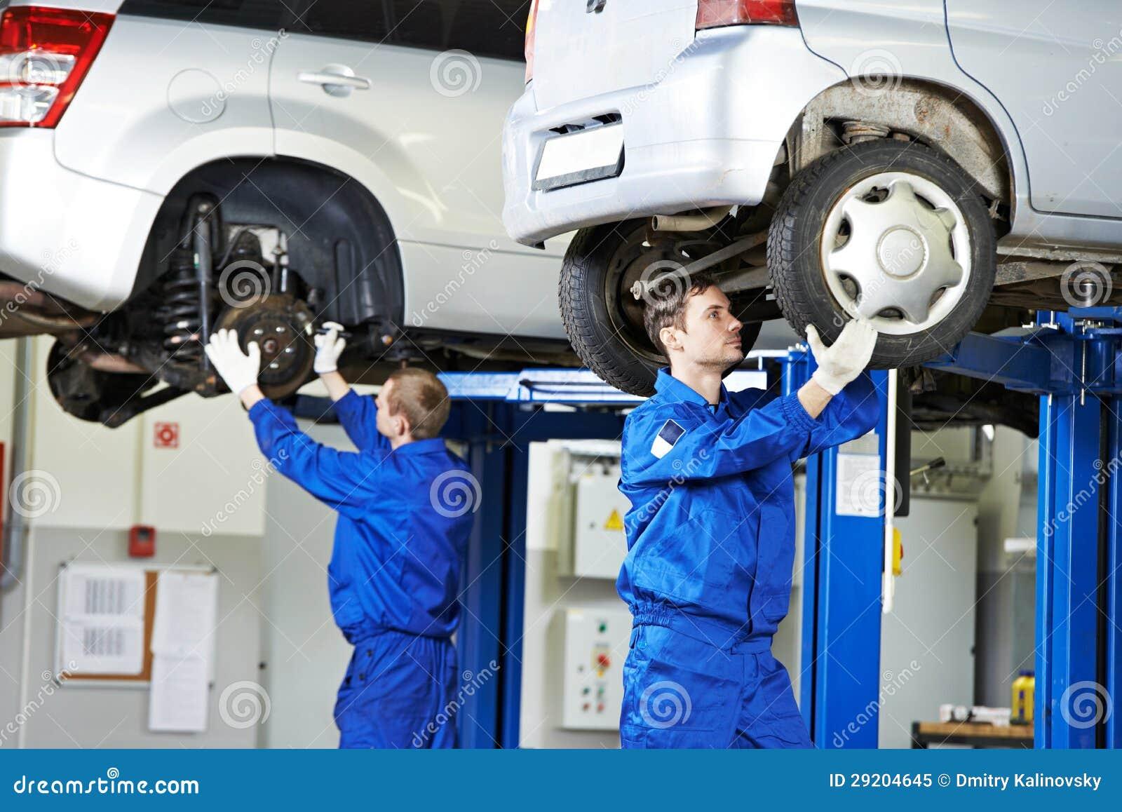Auto mechanic at car suspension repair work royalty free for Motor vehicle repair license