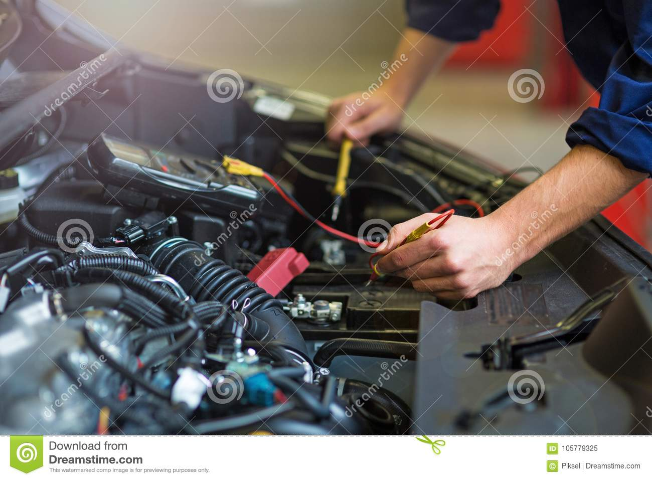 Auto Mechanic Checking Car Battery Voltage Stock Image Image Of