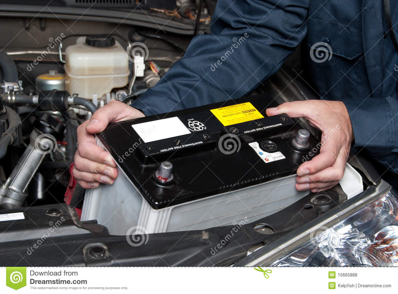 Person Holding Car Battery