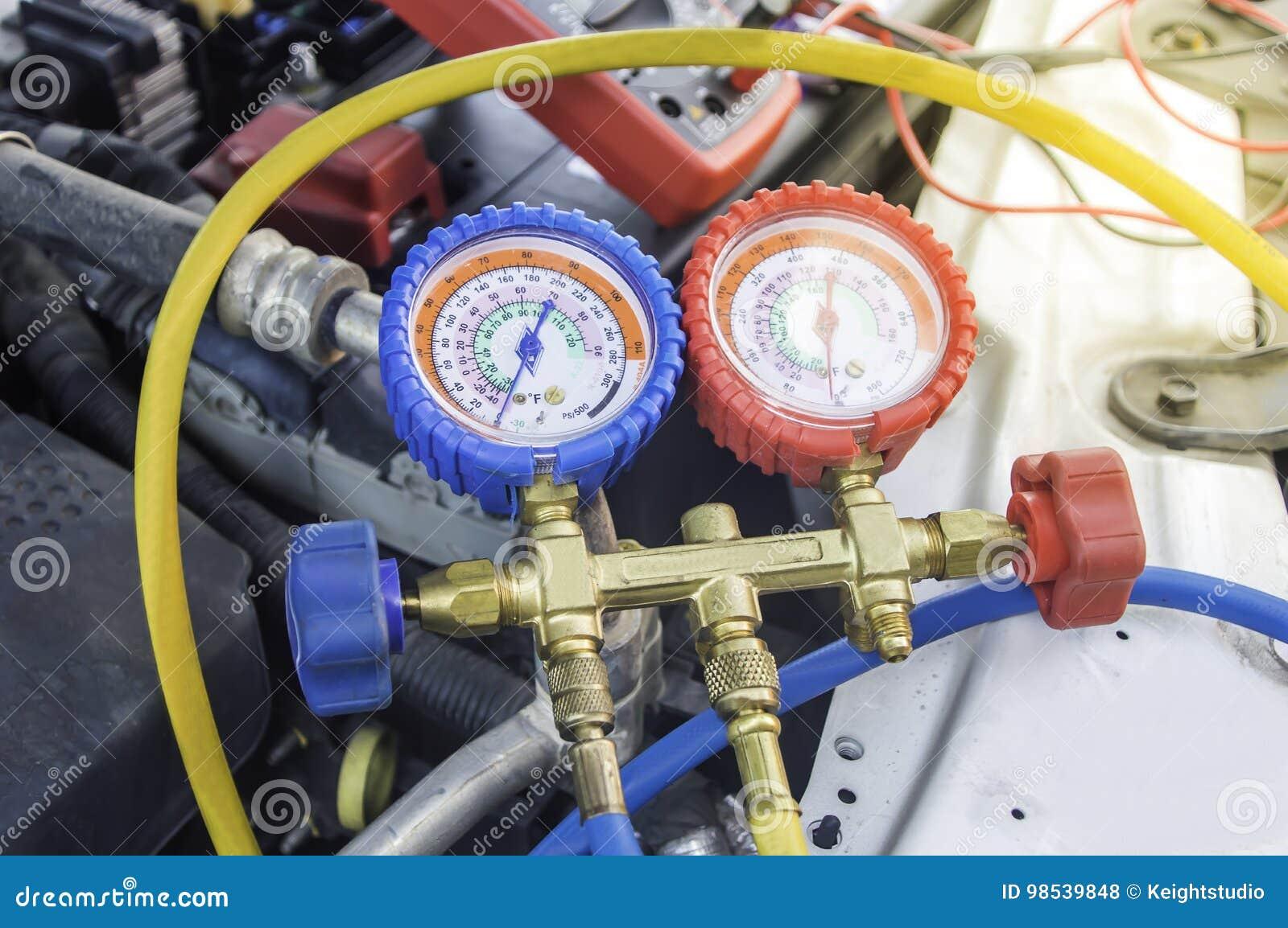 Auto Mechanic Uses A Pressure Gauge On The Air Compressor,liquid ...