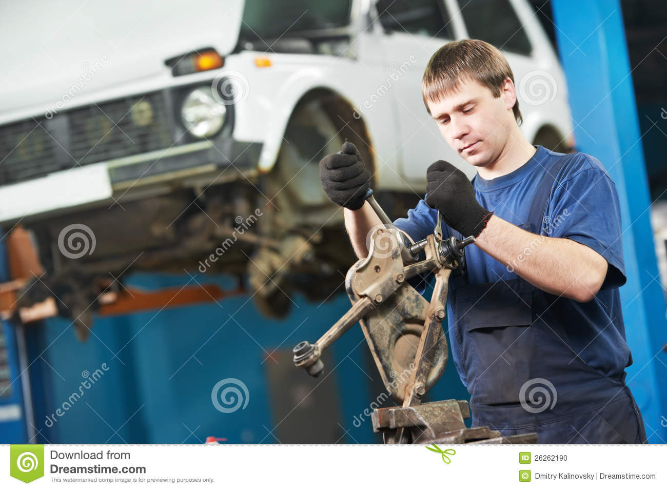 Car Repair And Maintenance >> Auto Mechanic At Work With Wrench Spanner Stock Photo - Image of adjustment, check: 26262190