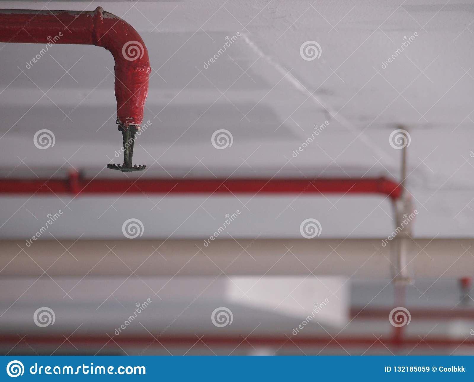 Automatic Fire Sprinkler In Red Water Pipe System Stock Image