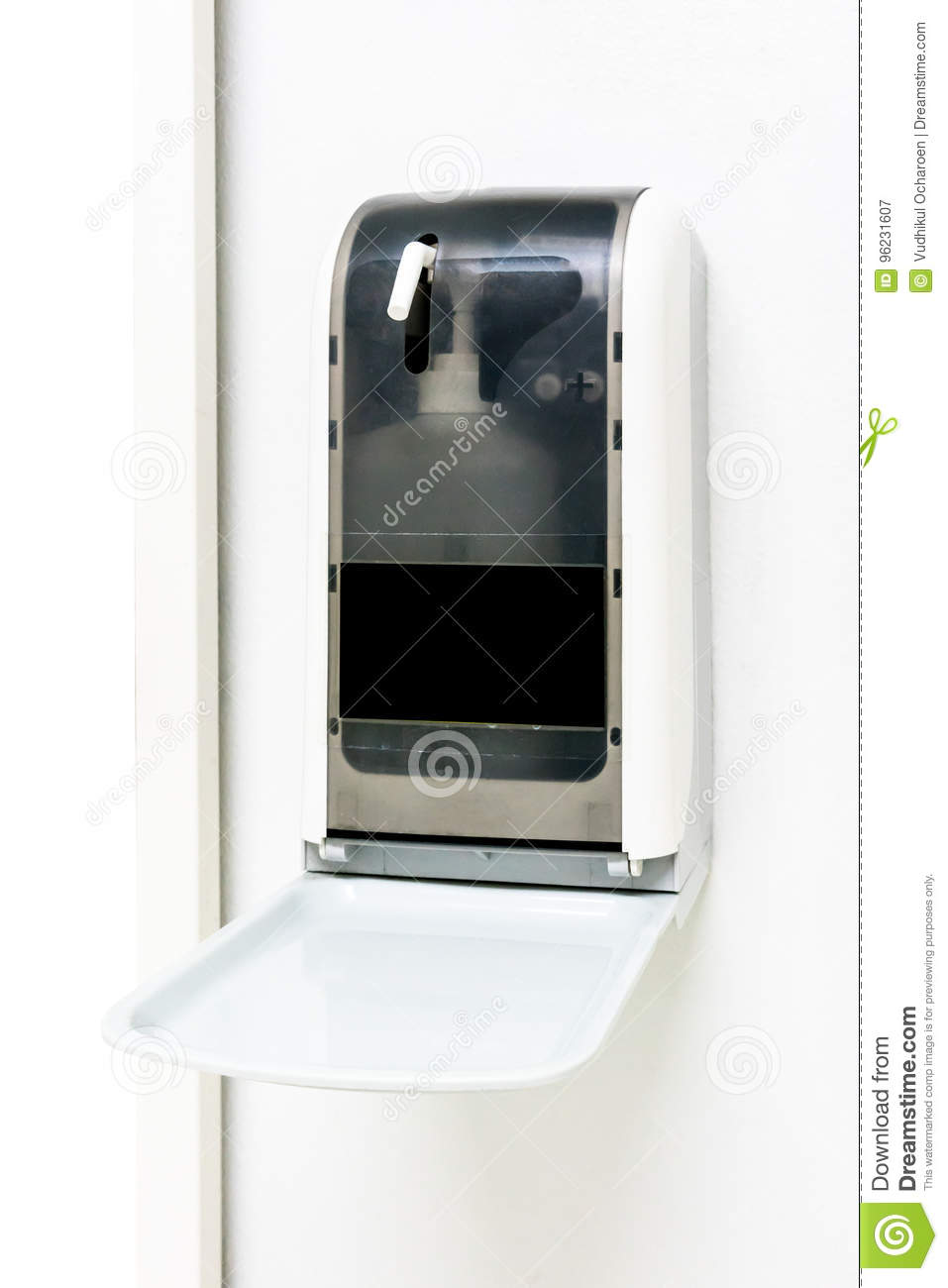 Automatic hand sanitizer dispenser on white wall