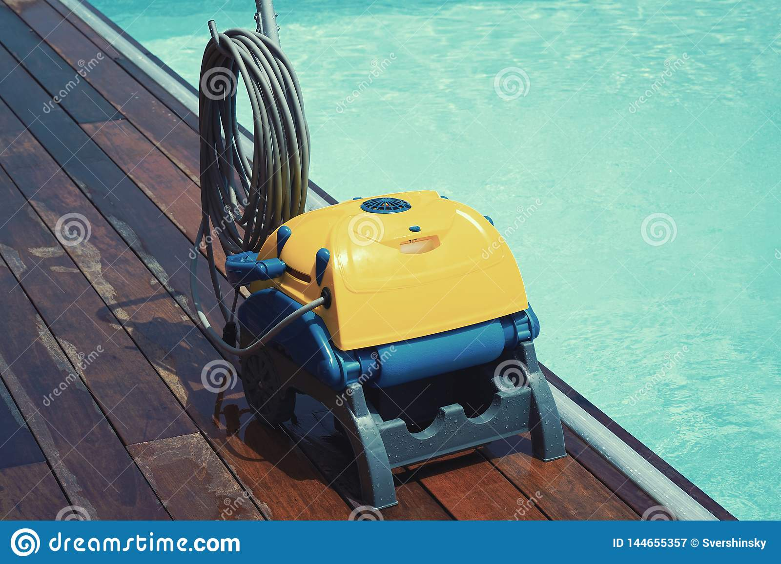 Automatic pool cleaners stock image. Image of people - 144655357