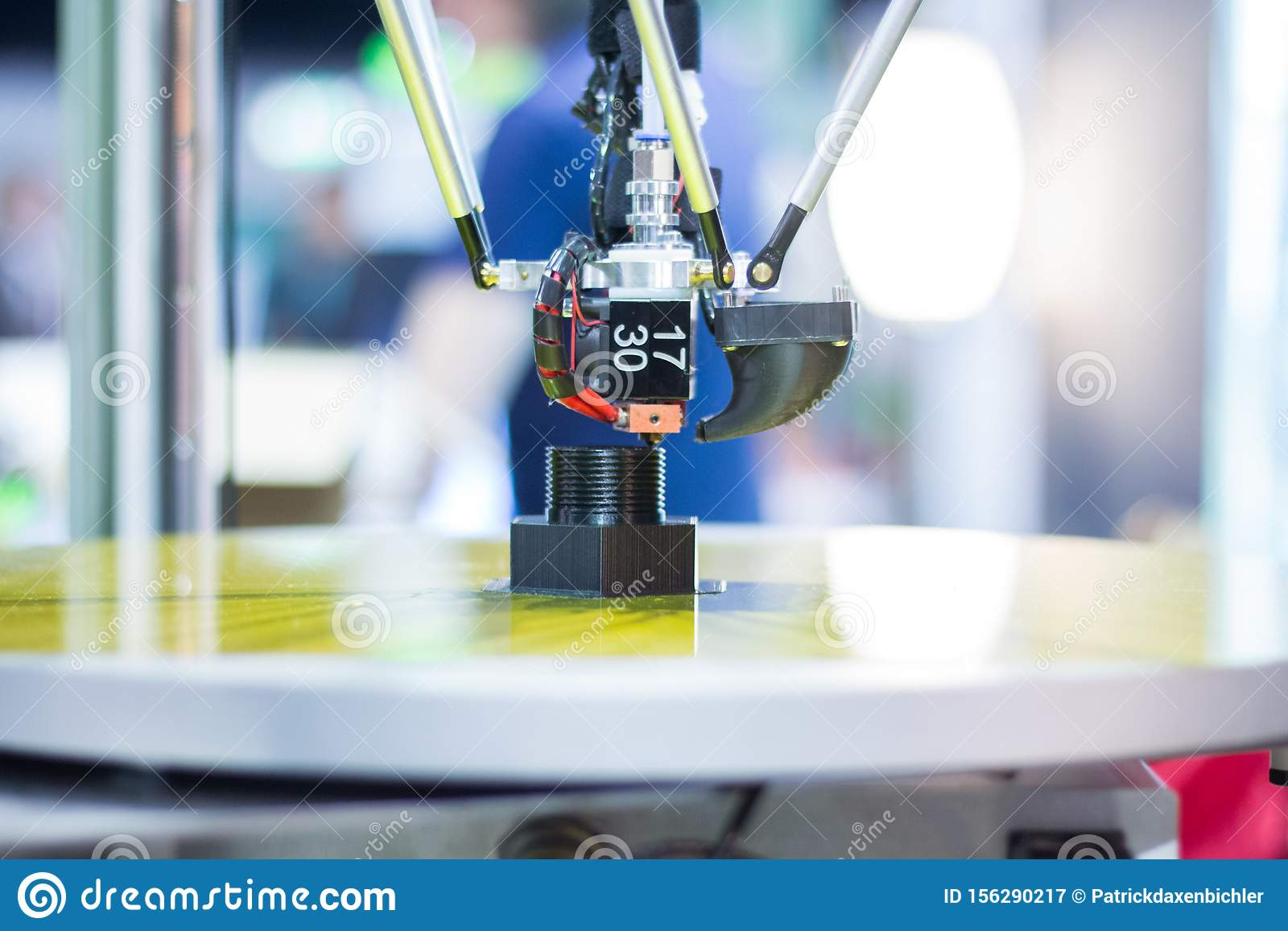 Automatic three-dimensional 3d printer performs product creation. 3d printing and automatic robotic technology, close-up