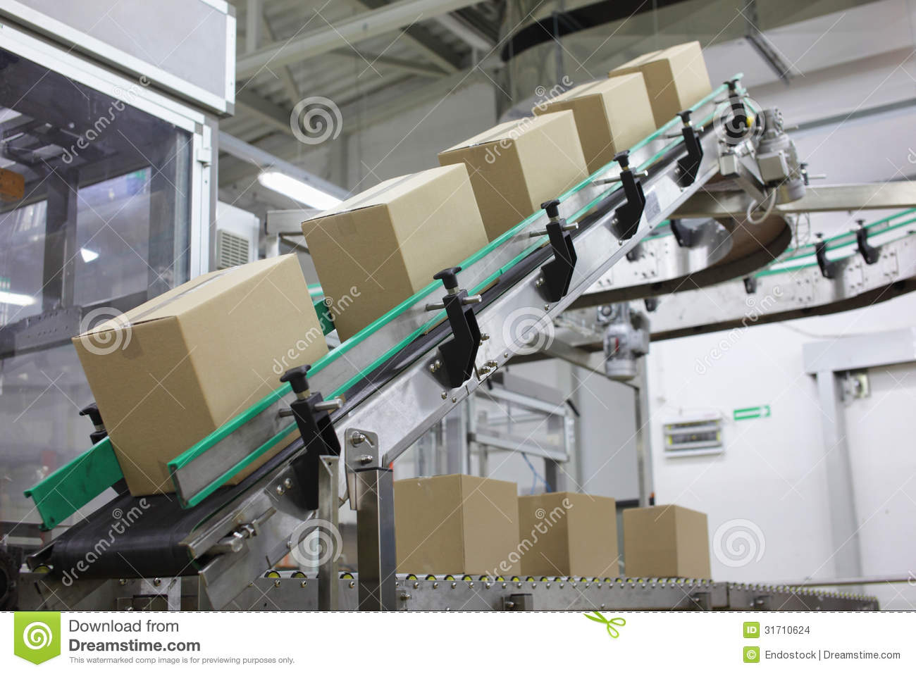 Automation Boxes On Conveyor Belt In Factory Stock Photo