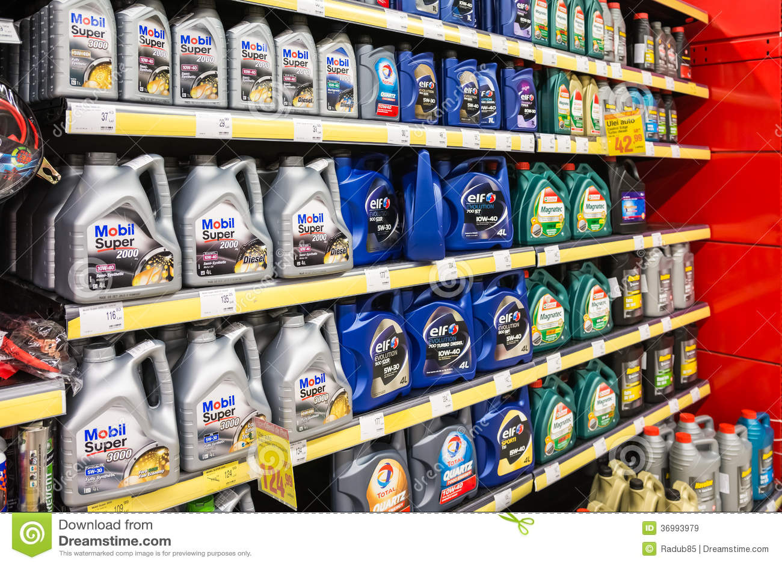 automobile motor oil on supermarket shelf editorial stock