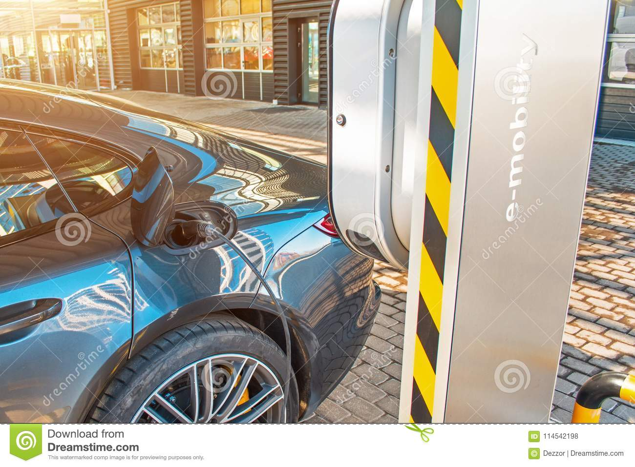 Automobile refueling for electric cars e-mobility in the background e-car, wheel. Charging e-car, the fuel cell battery door is op