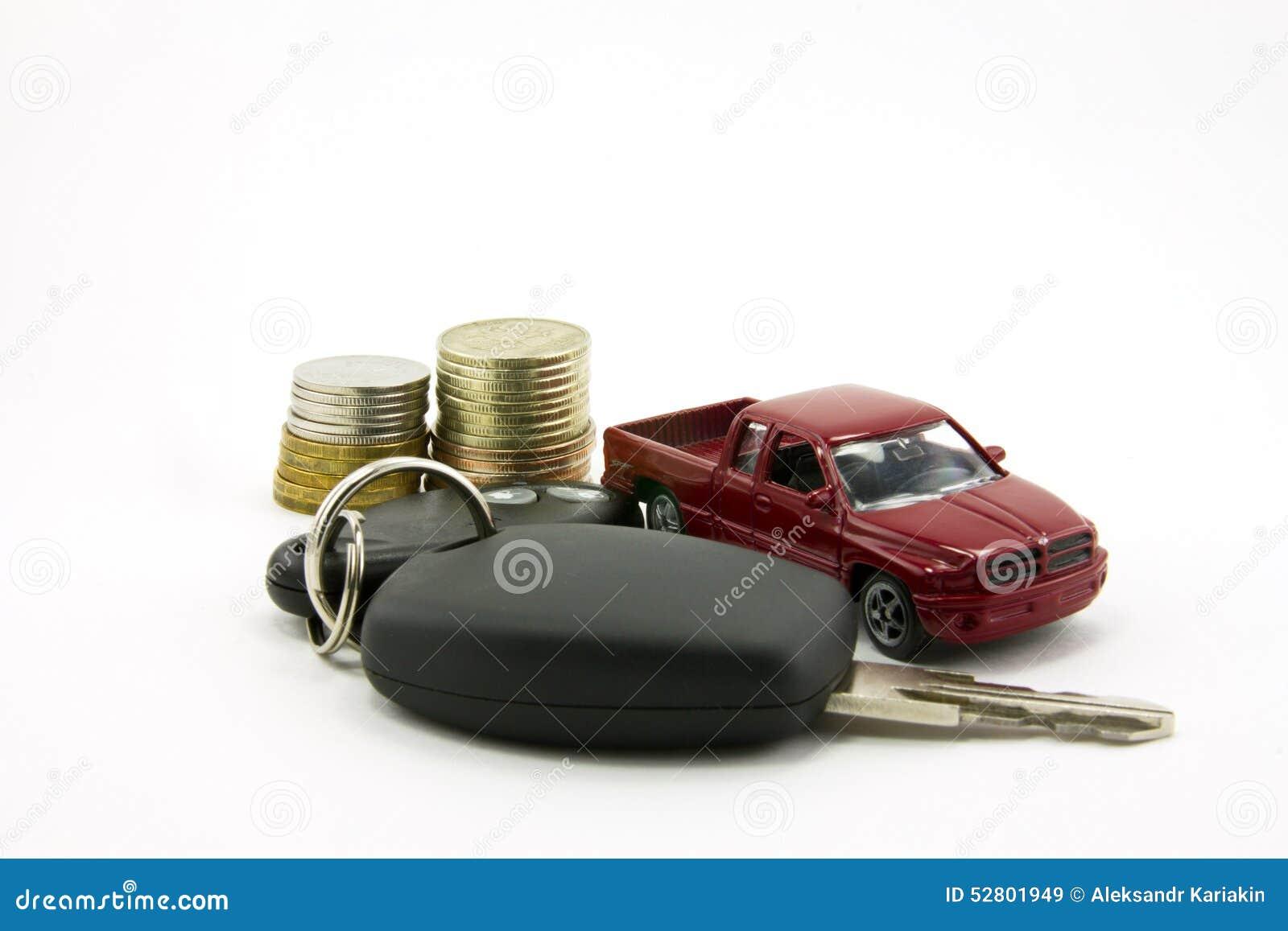 Autosleutels en stuk speelgoed auto en geld