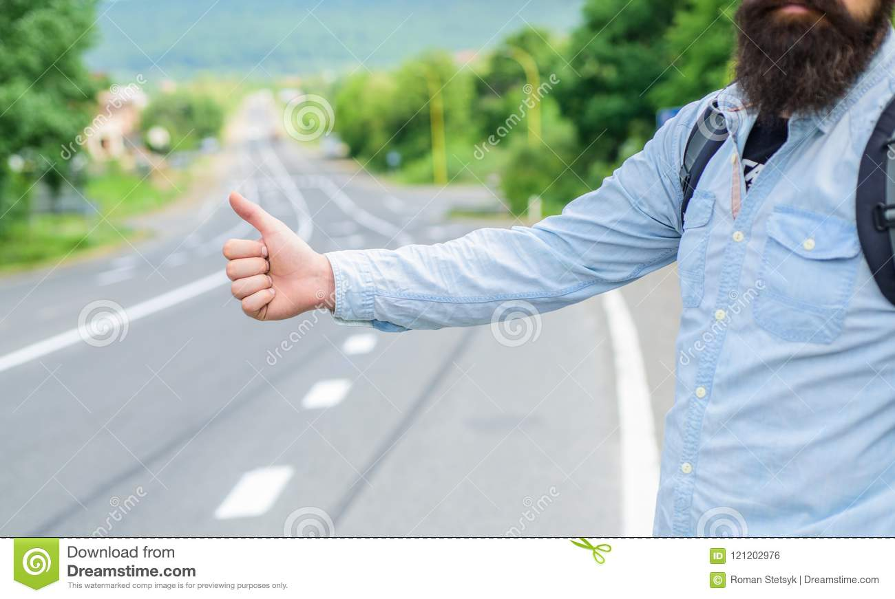 Autostop travel. Pick me up. Thumb up gesture try stop car road background. Hand gesture hitchhiking. Make sure you know