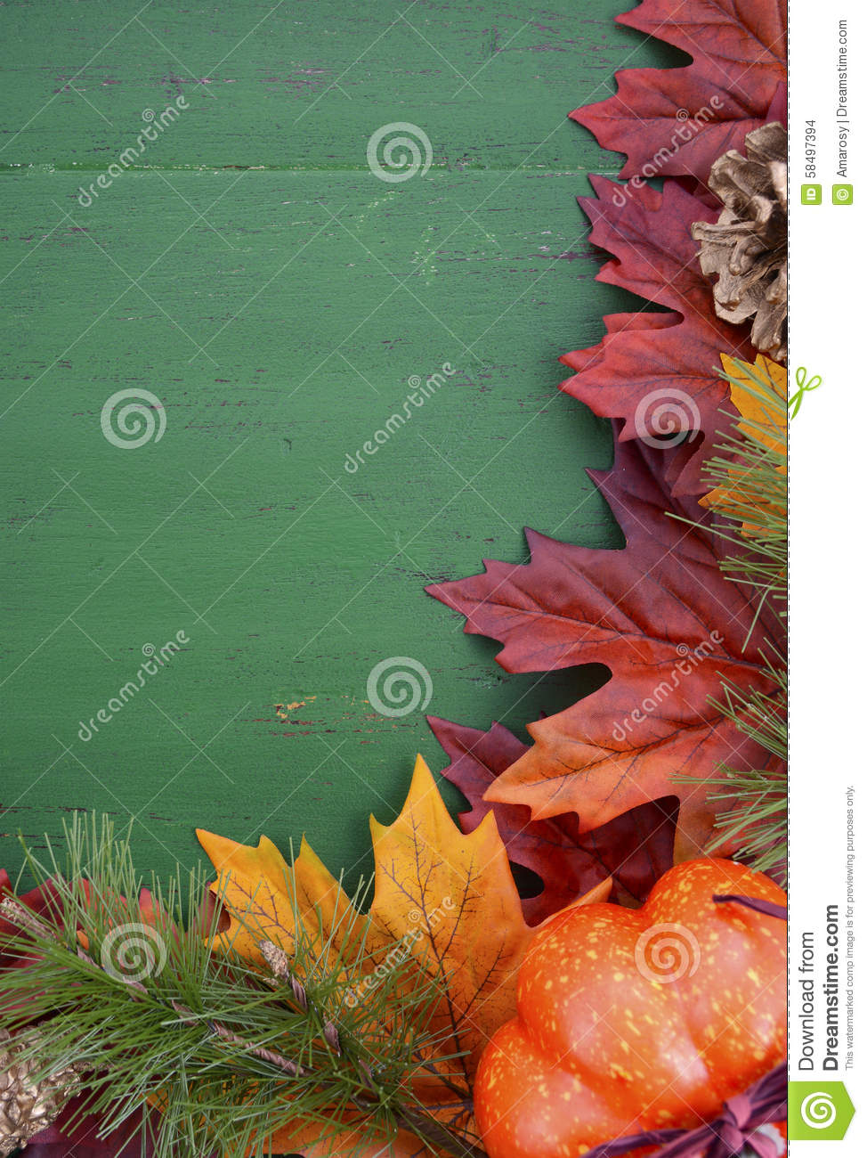 Autumn Fall Rustic Background On Green Vintage Distressed Wood With Leaves And Decorations