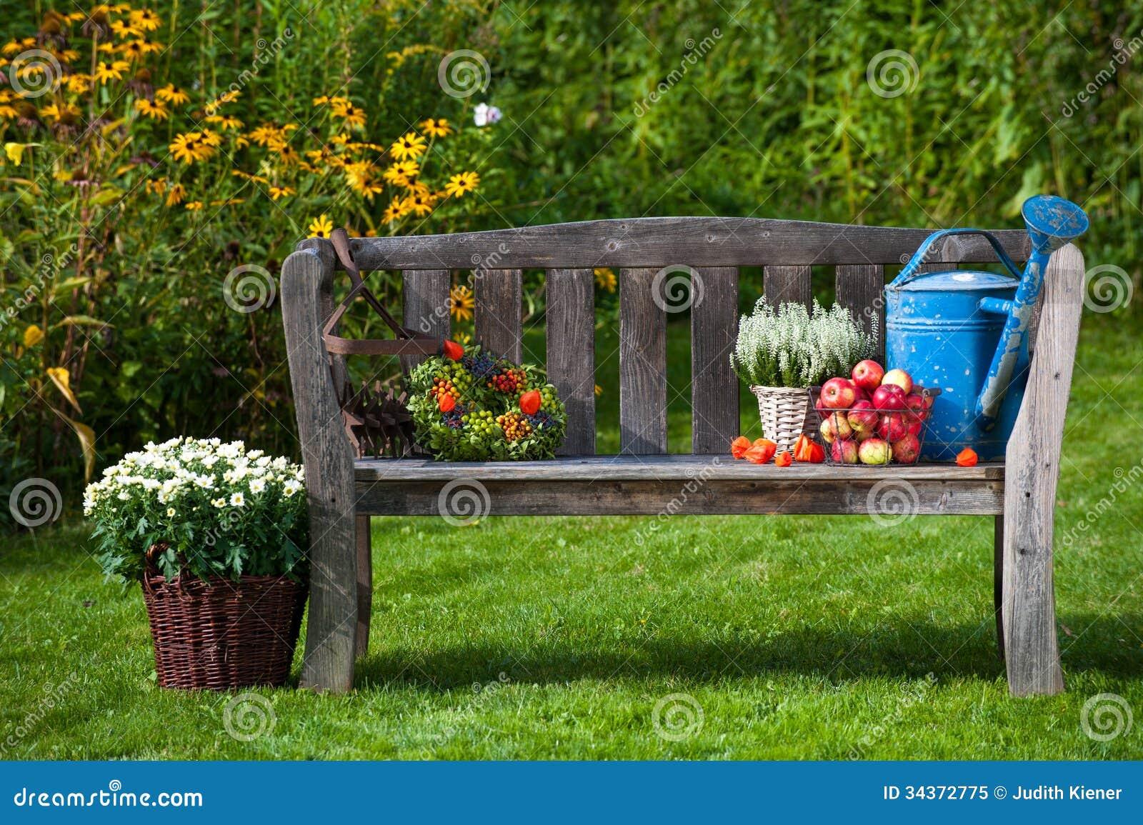Garden bench with autumn decoration.