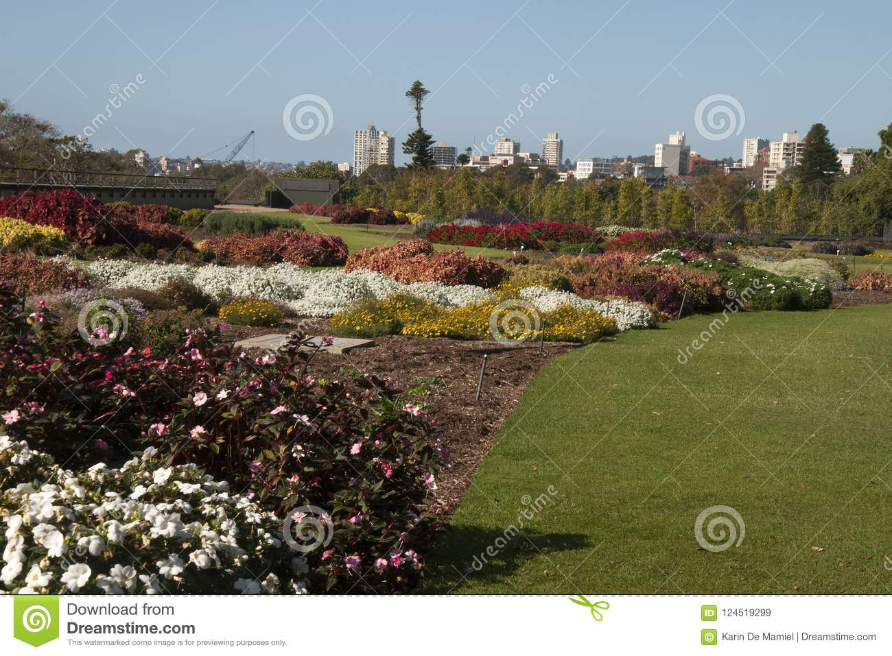 Panoramic view across park gardens to city skyline