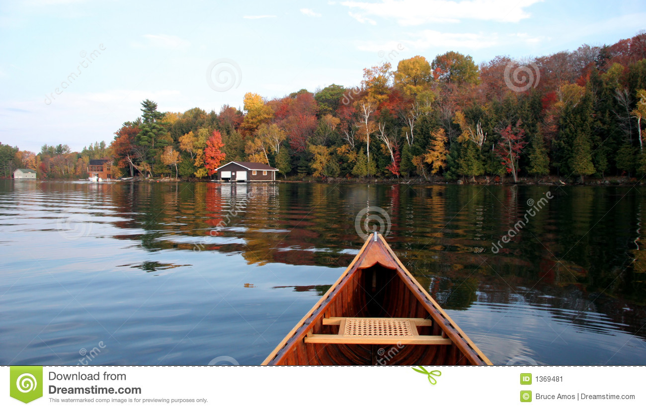 Autumn Lake Reflection With A Canoe Stock Image - Image of reflection, liquid: 1369481