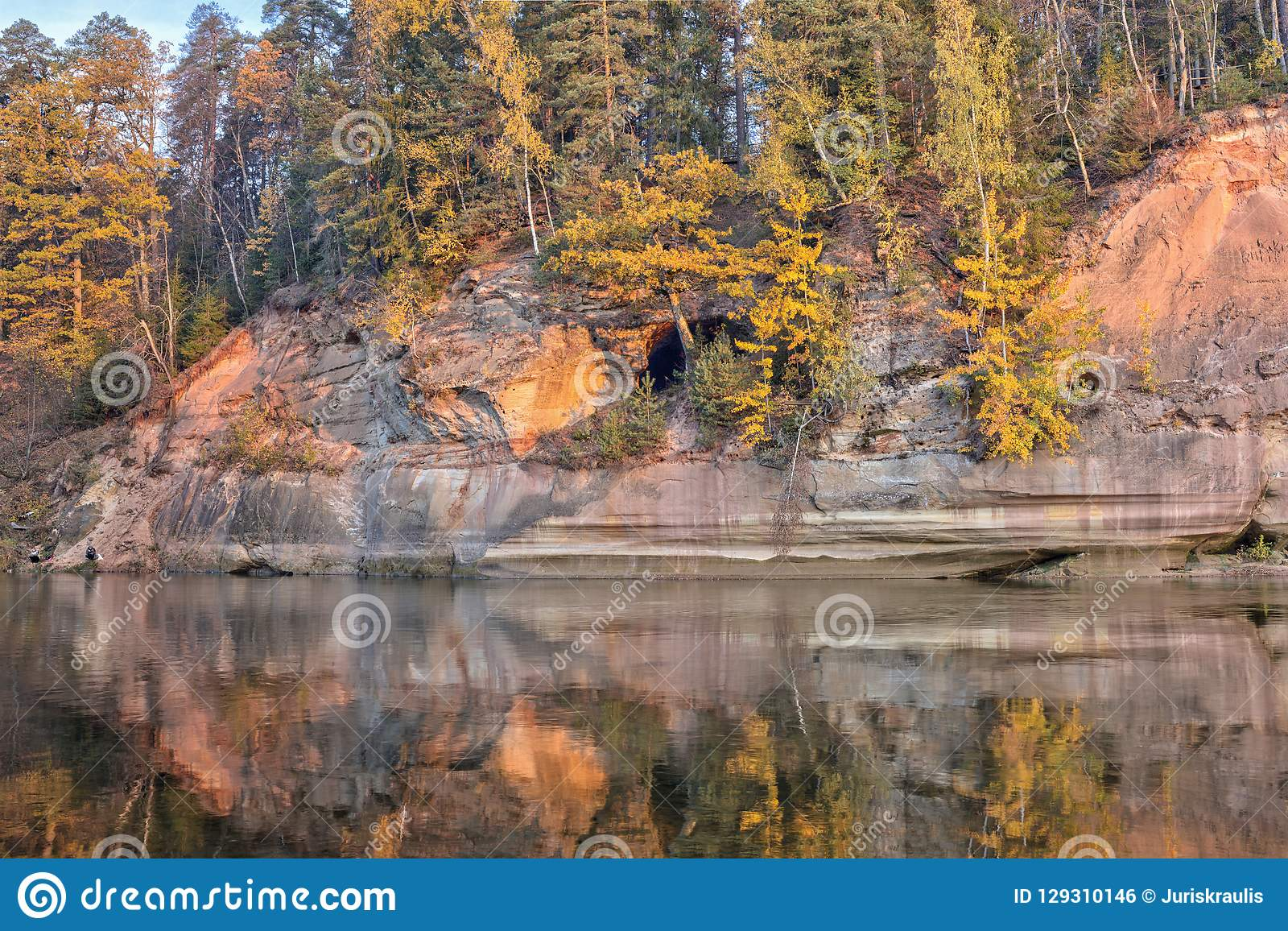 Autumn Landscape And Red Stone Cliff Of Gauja River, Latvia, Europe