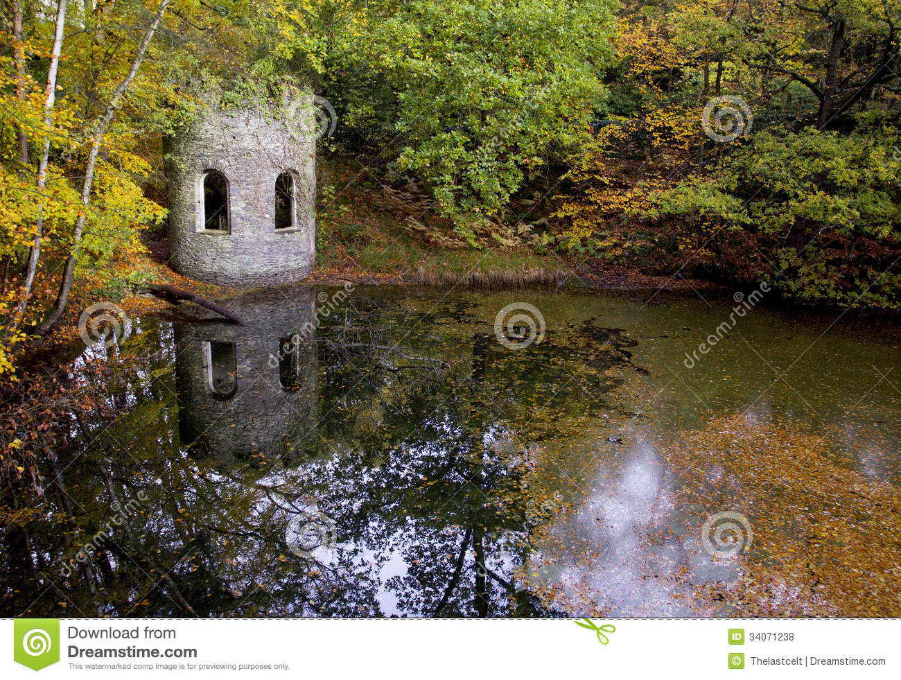 Autumn Leaves Around A Victorian Folly And Old Quarry Pond ...