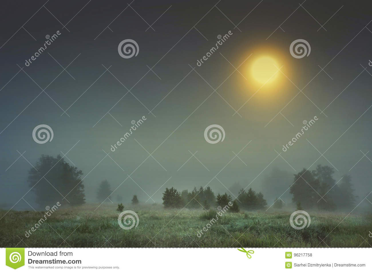 Autumn night landscape of cold foggy nature with large bright yellow moon in sky.