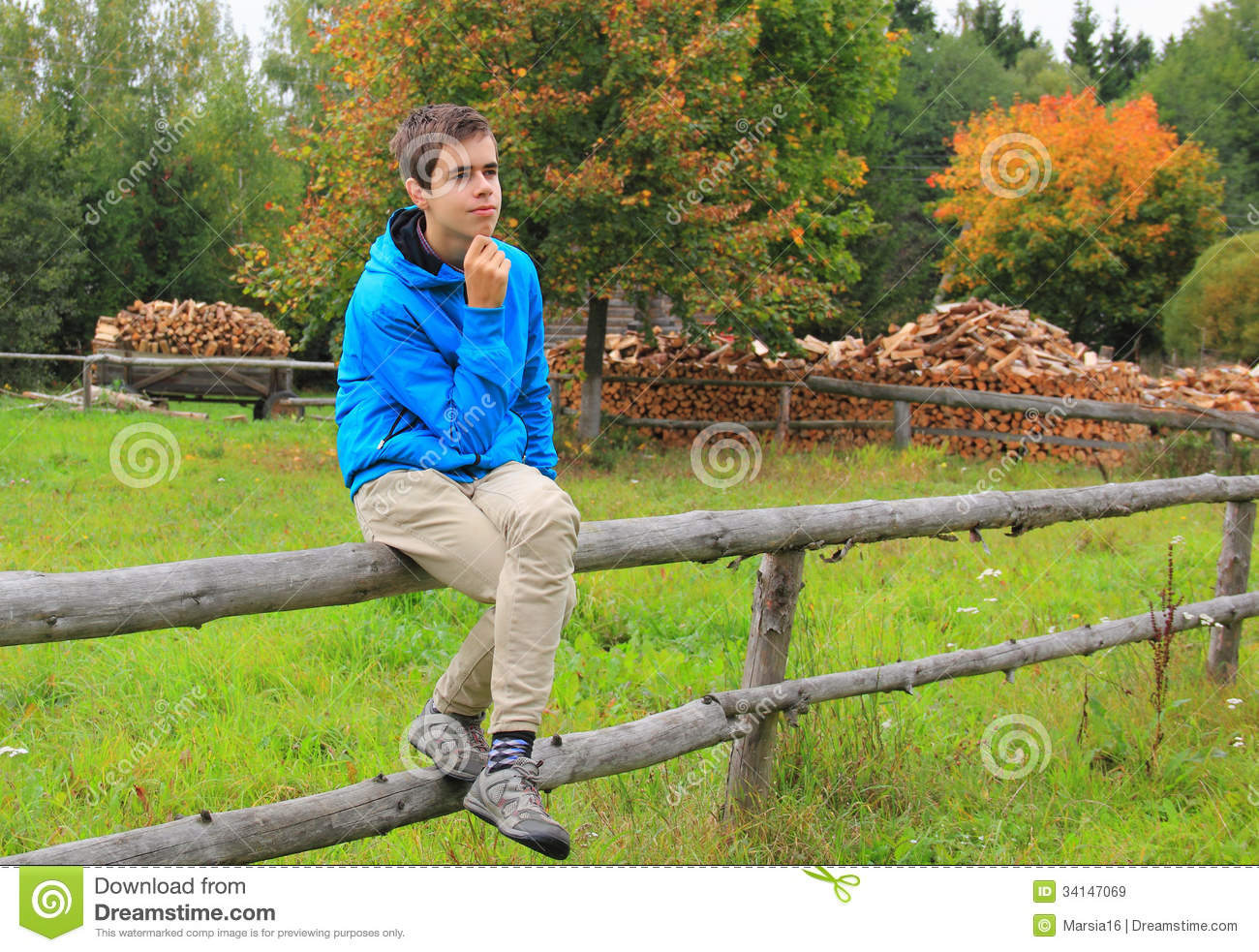 ... Boy Sitting On A Fence Royalty Free Stock Images - Image: 34147069
