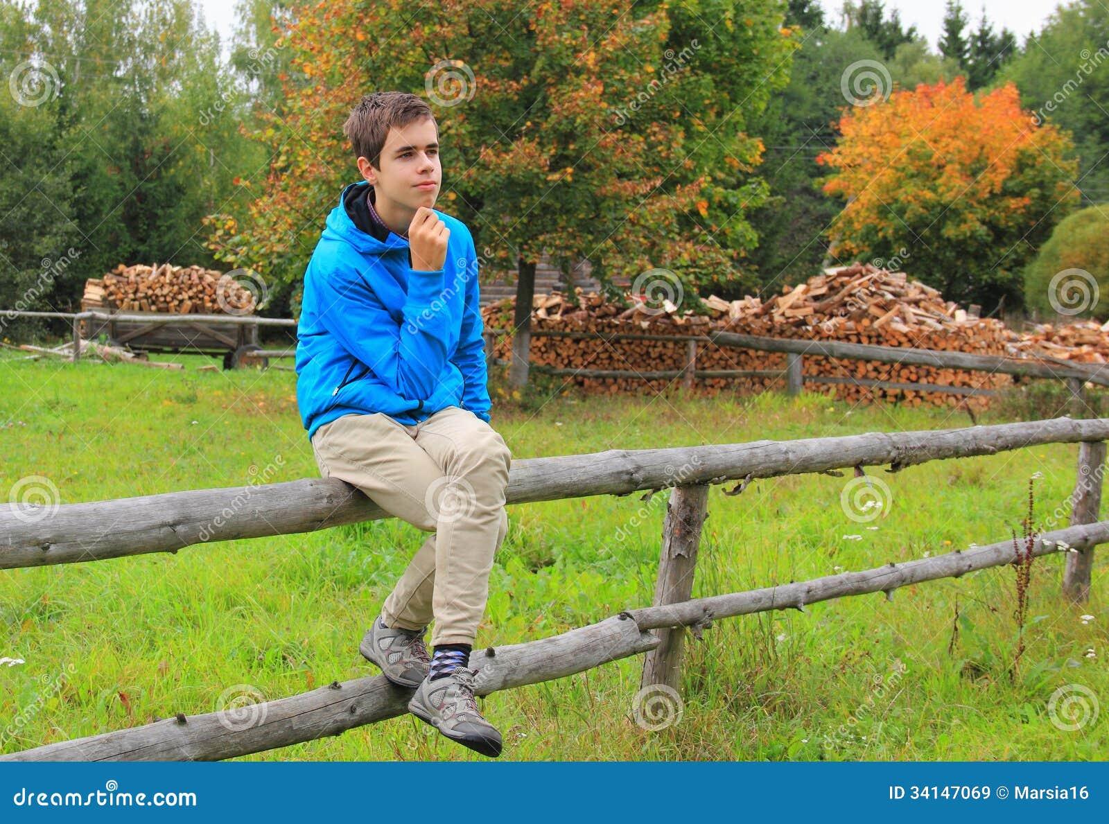 Teenage Boy Sitting On A Fence Royalty Free Stock Images - Image: 34147069