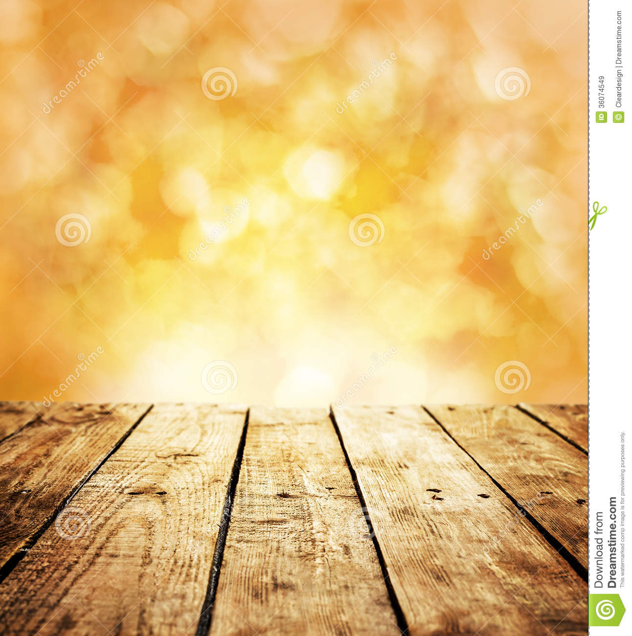 ... table in perspective on warm orange abstract bokeh - outdoor in the