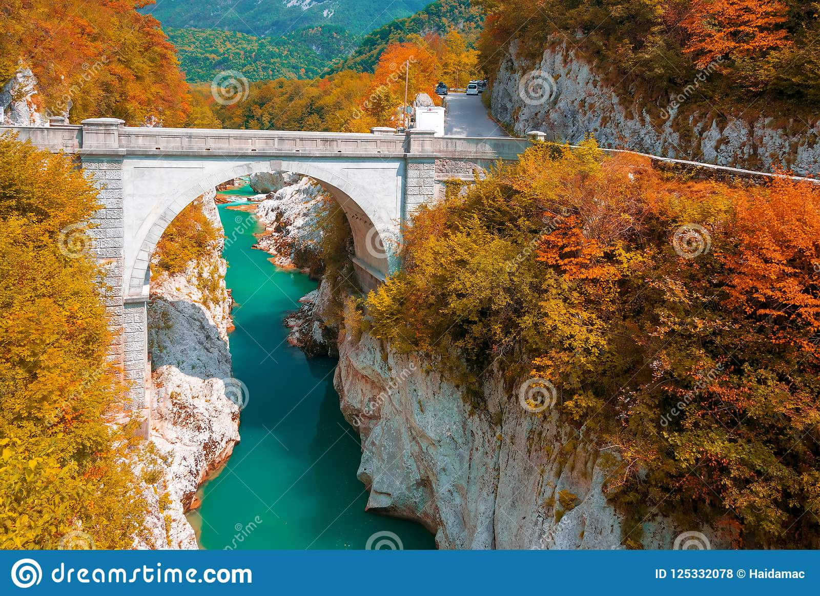 Autumn scenery of Soca river and Napoleon`s bridge near Kobarid, Slovenia