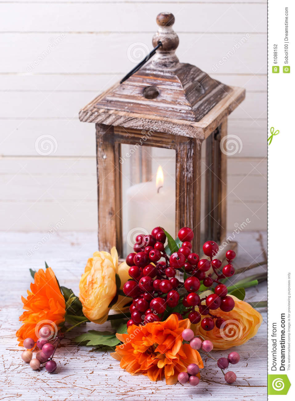 Autumn still life photo with flowers in yellow colors and candl