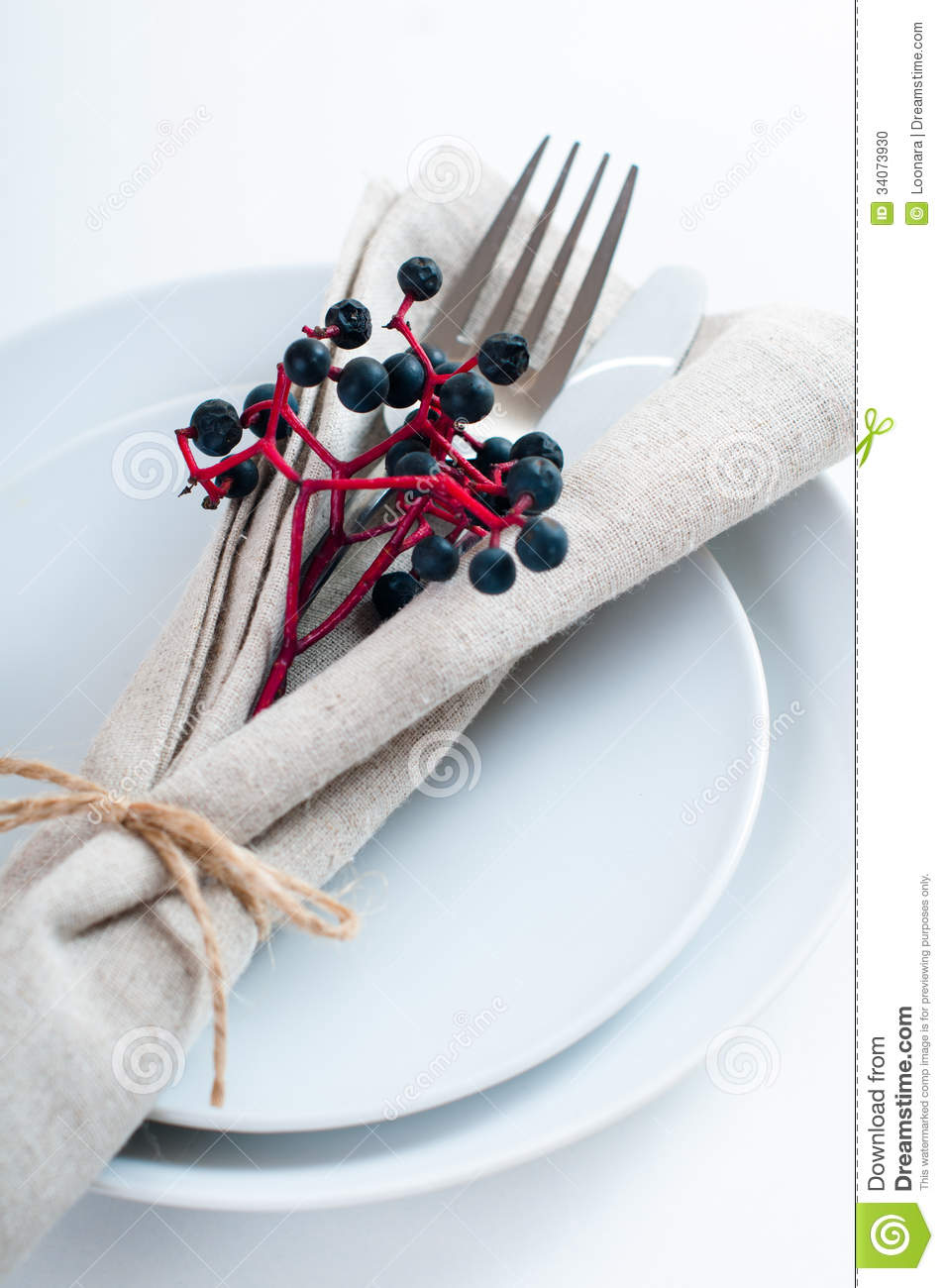 Autumn table setting with wild grapes dried herbs and berries in a