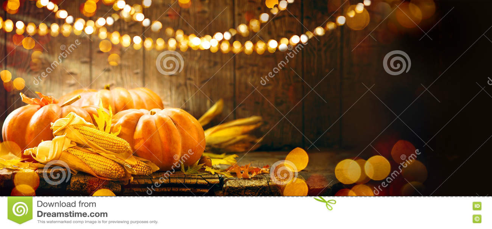 Autumn Thanksgiving pumpkins over wooden background