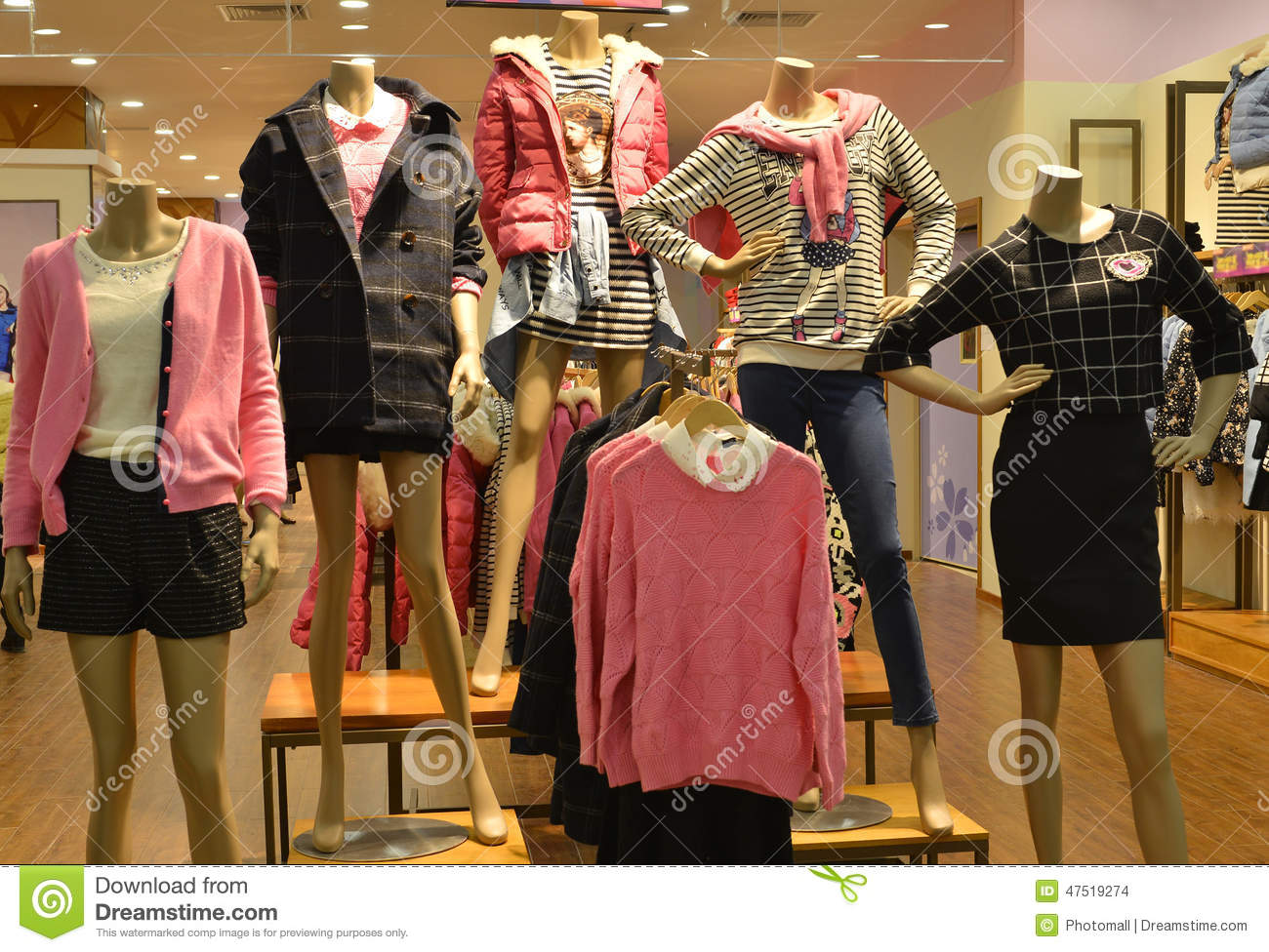 552ea90979bc7 Mannequins in fashion clothing store. display with mannequins in shopping  mall in Guangzhou (Kwangchow) City, Guangdong (Canton) province, China. A  display ...