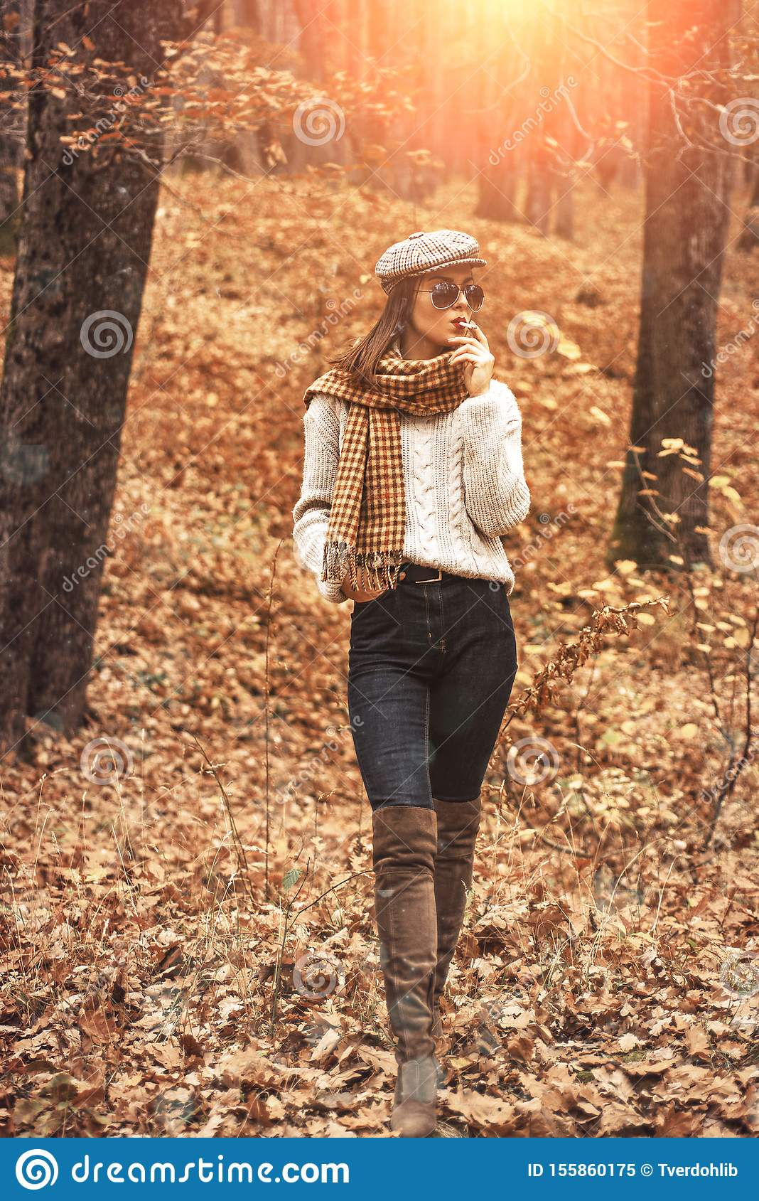 Autumn Woman enjoy smoking alone. Lonely smoker. Autumn is here. Pretty woman in hat and sunglasses smoking cigarette