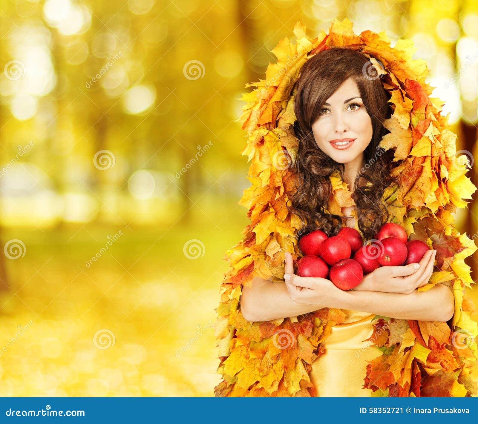 Autumn Woman hållande äpplen, modemodell i gula nedgångsidor