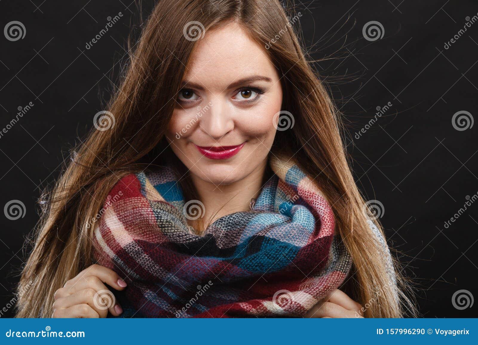 Smiling girl wearing warm wooden scarf