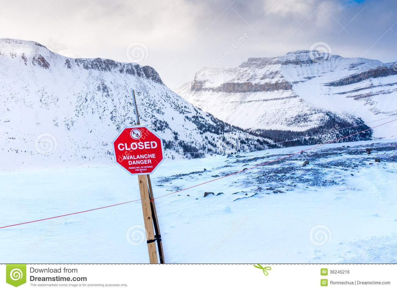 Avalanche danger stock photo image of slope fence