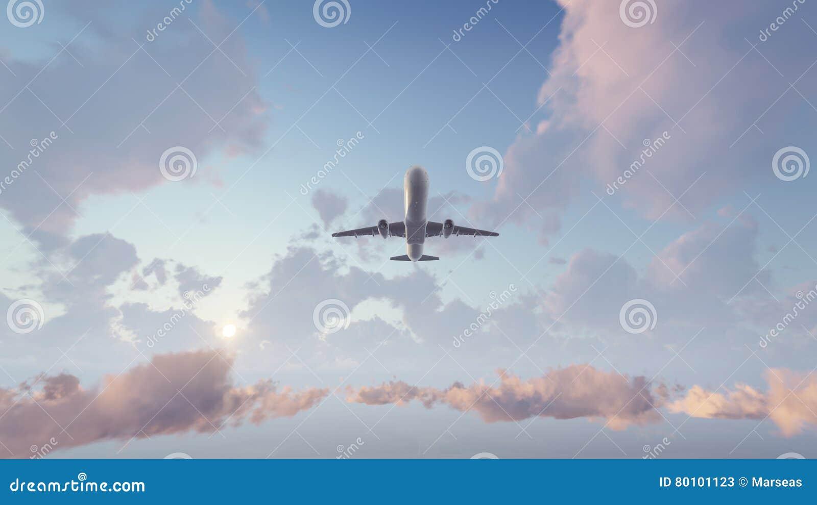 Avião do passageiro que descola no céu do por do sol