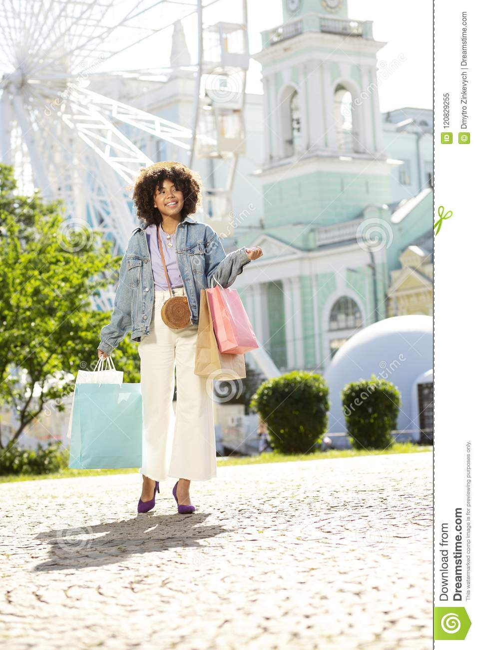 Charming Curly Girl Coming Back From Shopping Stock Image - Image of