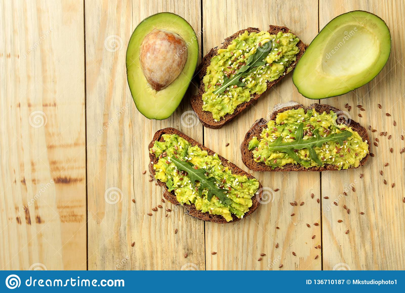 Avocado And Arugula Sandwiches Closeup On Natural Wooden ...