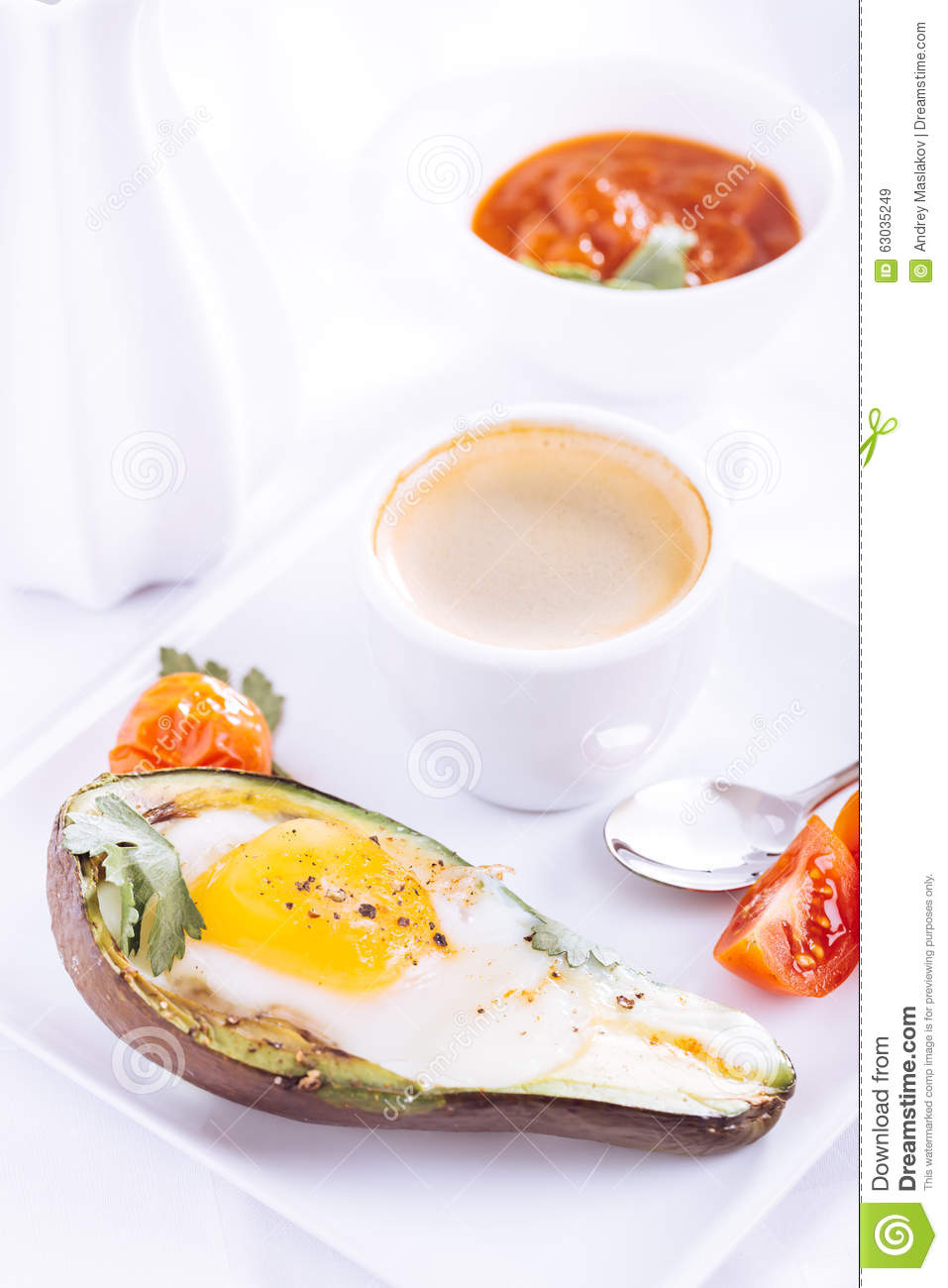 Avocado baked with egg and coffee