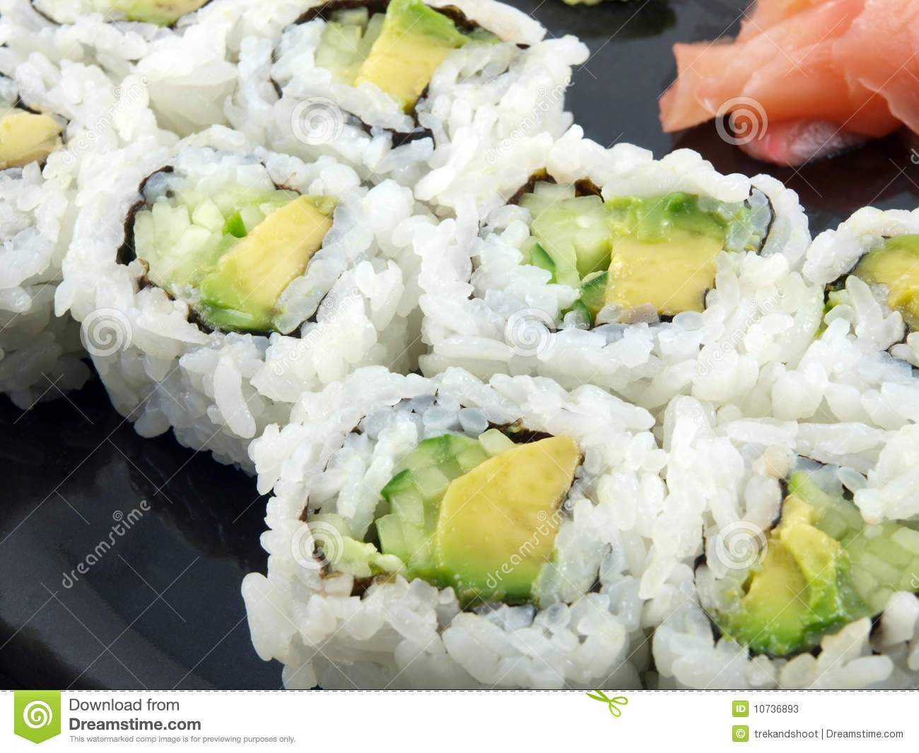 Avocado and Cucumber Sushi Roll with ginger. Vegetarian Japanese food.